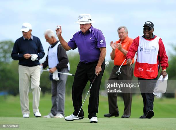 Jim Colbert waves his golf ball after making his birdie putt on the 18th hole during the final round of the Demaret Division at the Liberty Mutual...