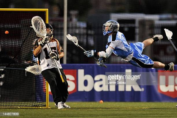Jim Connolly of the Ohio Machine leaps and fires a shot for a goal on goalie John Galloway of the Rochester Rattlers in the second quarter on May 19...