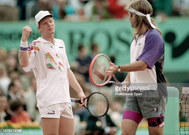 Jim Courier and Andre Agassi of the United States exchange words during the 1991 French Open Men's Final on Day 14 at Roland Garros on June 9 1991 in...