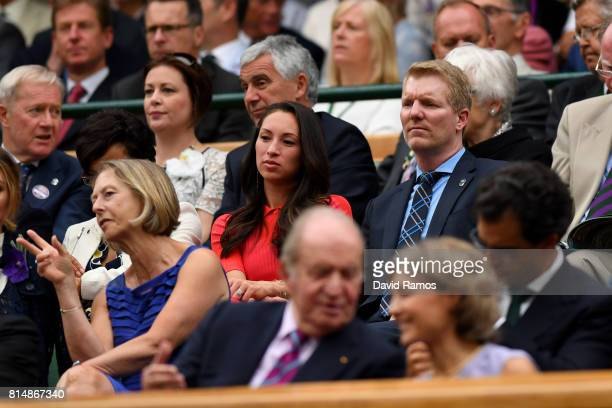Jim Courier and wife Susanna look on from the centre court royal box prior to the Ladies Singles final between Venus Williams of The United States...