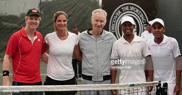 Jim Courier Joelle Shad John McEnroe Fernando Concepcion and Pedro Nolasco who played the doubles exhibition pose for photos after an exhibition...