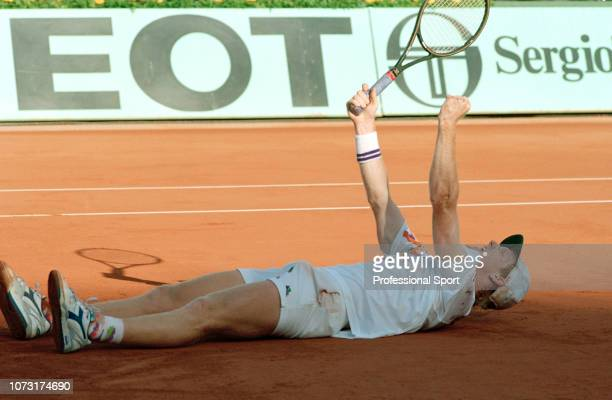 Jim Courier of the United States celebrates after defeating Andre Agassi of the United States to win the men's singles final during day fourteen of...