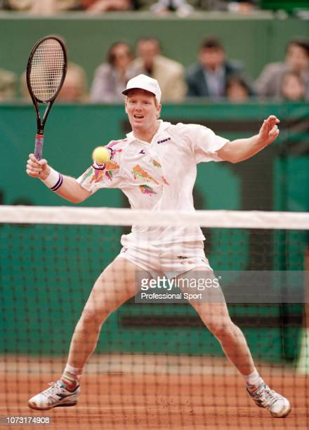Jim Courier of the United States in action against Andre Agassi of the United States during the men's singles final on day fourteen of the 1991...