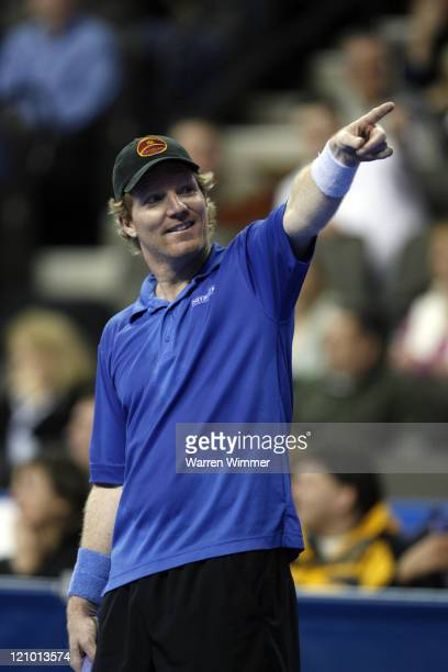 Jim Courier points to a heckler/fan during an exhibition match at the Mercedes Benz Classic Tennis Tour at Chicago's newest sports venue, The Sears...