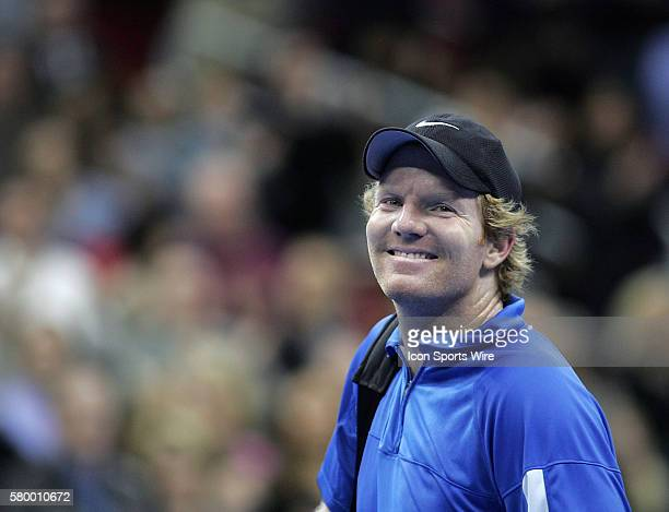 Jim Courier smiles at the crowd while leaving the court during the Serving for Tsunami Relief tennis match at Toyota Center in Houston Texas Tennis...