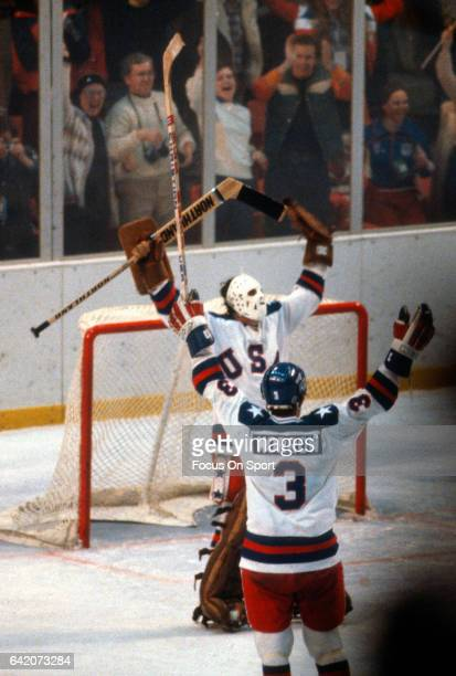 Jim Craig and Ken Morrow of the United States Hockey team celebrates after they defeated the Soviet Union during a metal round game of the Winter...