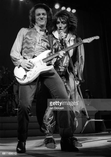 Jim Cregan and Rod Stewart performing on stage at Grand Hall Olympia London 21 December 1976