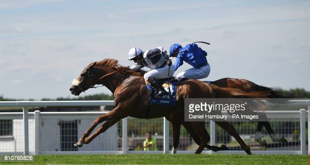 Jim Crowley on board Ulysses wins ahead of James Doyle on board Barney Roy in The CoralEclipse race during the Summer Festival at Sandown Park...