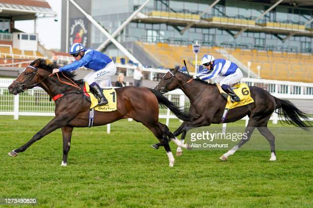 Jim Crowley riding Alkumait win The Dubai Duty Free Mill Reef Stakes from Silvestre De Sousa and Fivethousandtoone at Newbury Racecourse on September...