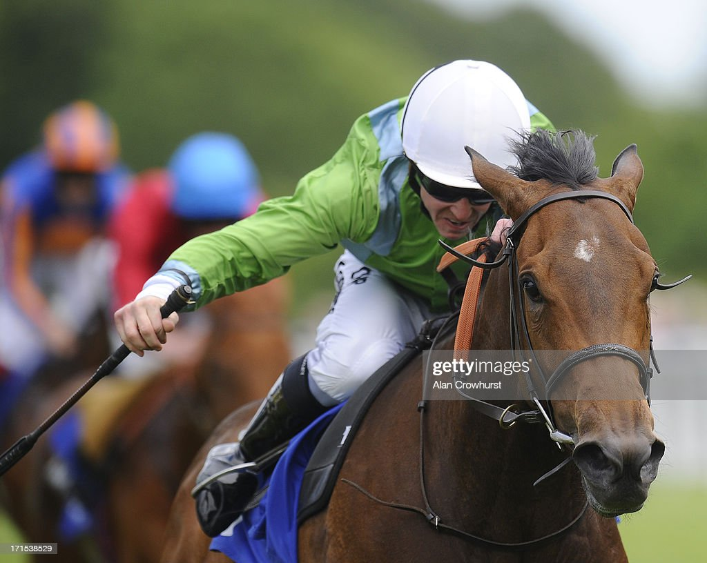 Jim Crowley riding Lunette wins The Smith & Williamson Maiden Fillies' Stakes at Salisbury racecourse on June 26, 2013 in Salisbury, England.
