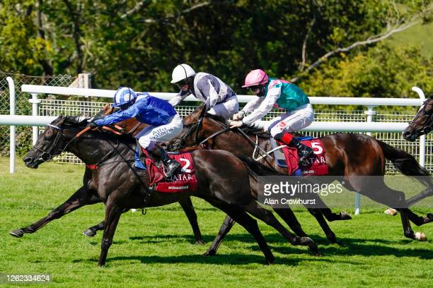 Jim Crowley riding Mohaather win The Qatar Sussex Stakes at Goodwood Racecourse on July 29, 2020 in Chichester, England. Owners are allowed to attend...
