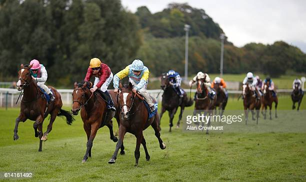 Jim Crowley riding Sea Tide finish third in The Kier Construction Central EBF Maiden Fillies' Stakes won by Andrea Atzeni riding Tansholpan at...