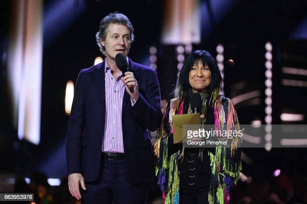 Jim Cuddy and Buffy SainteMarie present award at the 2017 Juno Awards at The Canadian Tire Centre on April 2 2017 in Ottawa Canada