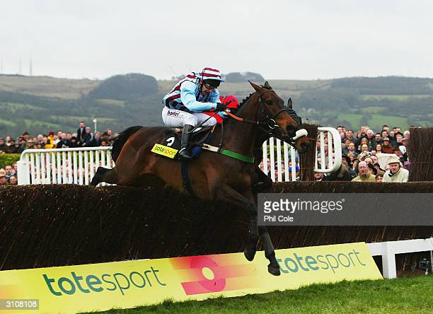 Jim Culloty and Best Mate clear the last fence in The totesport Cheltenham Gold Cup Chase on the third day of the annual National Hunt Festival held...
