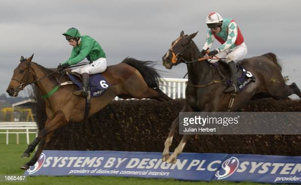 Jim Culloty and Lucky Bay lead the Ruby Wals ridden Joly Bey over the last fence to land The Novices Steeple Chase Race run at Newbury Racecourse on...