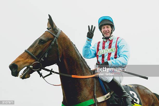 Jim Culloty shows his delight after Best Mate landed his 3rd Cheltenham Gold Cup Race run on the third day of the annual National Hunt Festival held...