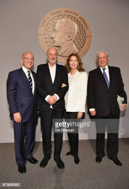 Jim Cuno Anselm Kiefer Maria HummerTuttle and Mario Vargas Llosa pose for a photo onstage during the Getty Medal Dinner 2017 at The Morgan Library...