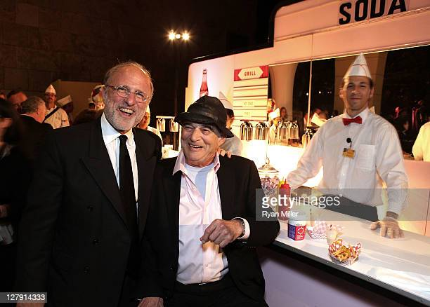 Jim Cuno, President and CEO J. Paul Getty Trust and artist Larry Bell pose at a 1950's era buffett during the Pacific Standard Time: Art in LA...