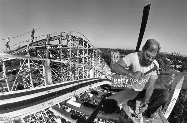 Jim Deak Coaster Carpenter at Elitch's amusement park works on the roller coaster this work is started every year when the park closes the carpenter...