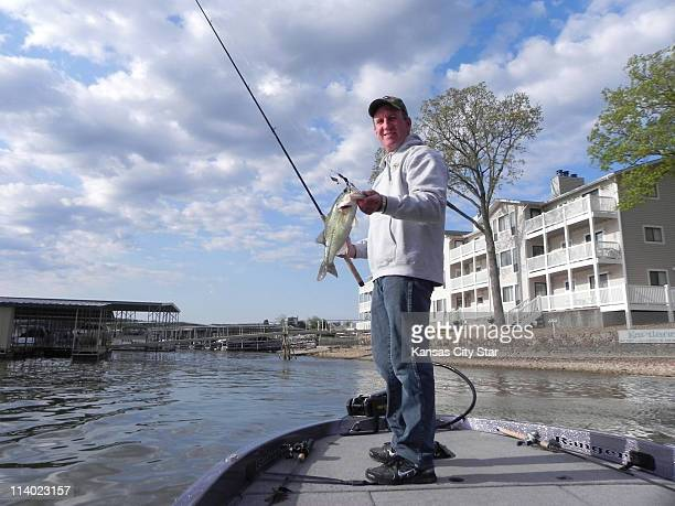 Jim Dill uses lures he makes himself when fishing on Lake of the Ozarks near Osage Beach Missouri
