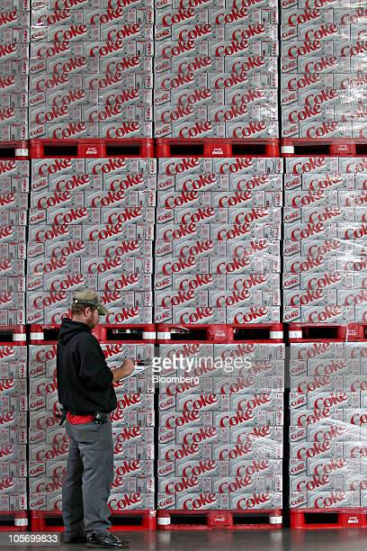 Jim Dimmick warehouse manager takes inventory of cases of CocaCola Diet Coke soda waiting to be loaded at the Swire CocaCola distribution facility in...