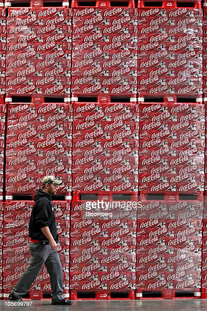 Jim Dimmick warehouse manager walks past pallets loaded with cases of CocaCola soda cans waiting to be loaded at the Swire CocaCola distribution...