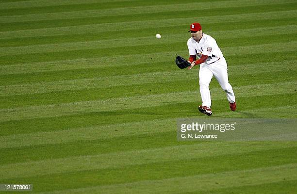 Jim Edmonds of St Louis makes a catch to hold runners on 2nd and 3rd base during game 5 action of the NLCS between the New York Mets and St Louis...
