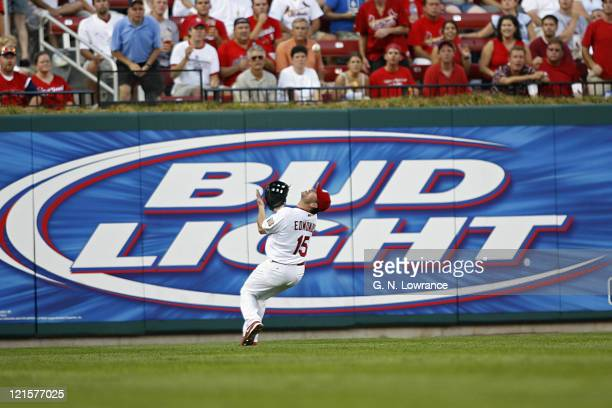 Jim Edmonds of St Louis makes an over the shoulder catch during action between the Los Angeles Dodgers and St Louis Cardinals at Busch Stadium in St...