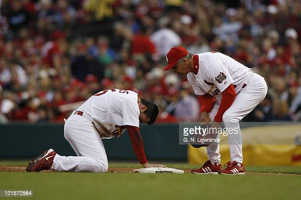 Jim Edmonds of the Cardinals winces after he was doubled up on first base during action between the New York Mets and the St Louis Cardinals at Busch...