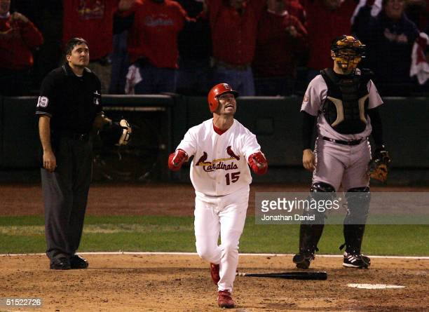 Jim Edmonds of the St Louis Cardinals celebrates after hitting a gamewinning tworun home run in the bottom of the 12th inning giving the Cardinals a...
