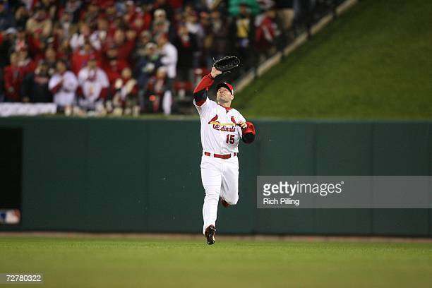 Jim Edmonds of the St Louis Cardinals lines up a catch during Game Five of the 2006 World Series on October 27 2006 at Busch Stadium in St Louis...