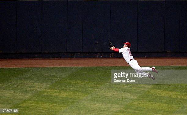Jim Edmonds of the St Louis Cardinals makes a diving catch in game seven of the National League Championship Series against the Houston Astros during...