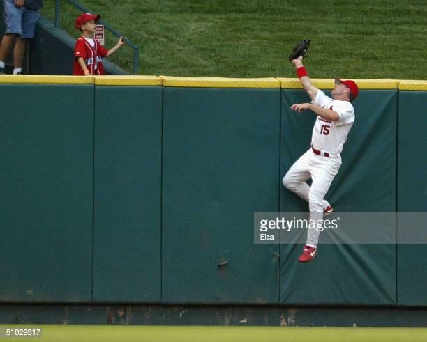 Jim Edmonds of the St Louis Cardinals robs Adam Dunn of the Cincinnati Reds of a home run in the second inning July 6 2004 at Busch Stadium in St...