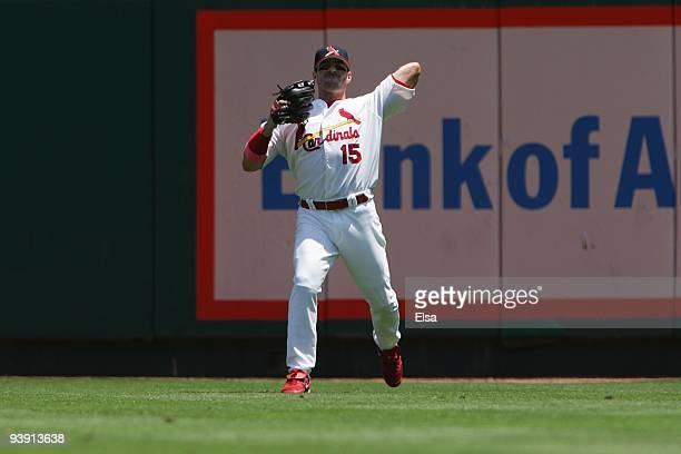 Jim Edmonds of the St Louis Cardinals throws against the New York Yankees on June 12 2005 at Busch Stadium in St Louis Missouri The St Louis...