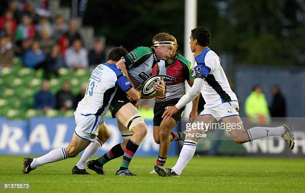 Jim Evans of Harlequins gets tackled by Matt Carraro of Bath during the Guinness Premiership game between Harlequins and Bath at the Stoop on October...