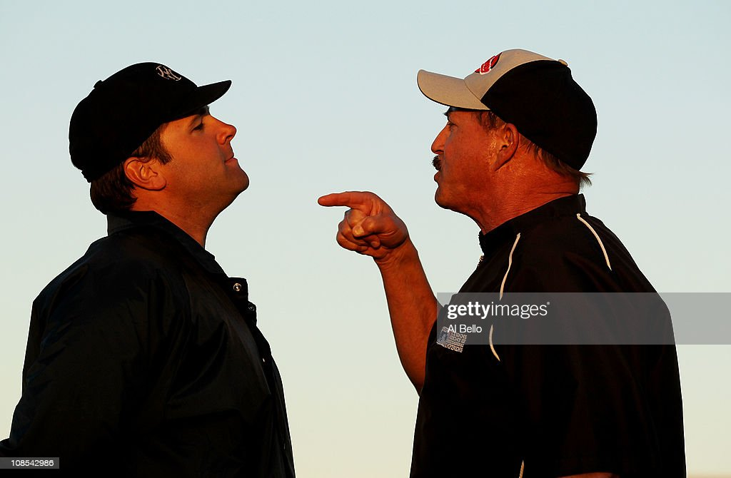 Jim Evans (r) performs an argument drill with a student (l) during the Jim Evans Academy of Professional Umpiring on January 28, 2011 at the Houston Astros Spring Training Complex in Kissimmee, Florida. Jim Evans was a Major League Umpire for 28 years that included umpiring four World Series. Many of his students have gone on to work on all levels of baseball including the Major Leagues.