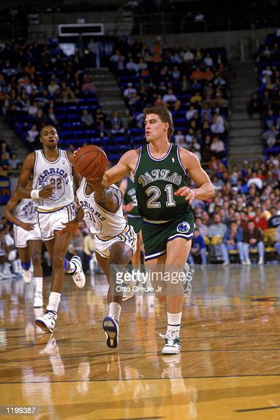 Jim Farmer of the Dallas Mavericks drives the ball upcourt during an NBA game against the Golden State Warriors at the Arena in Oakland California in...