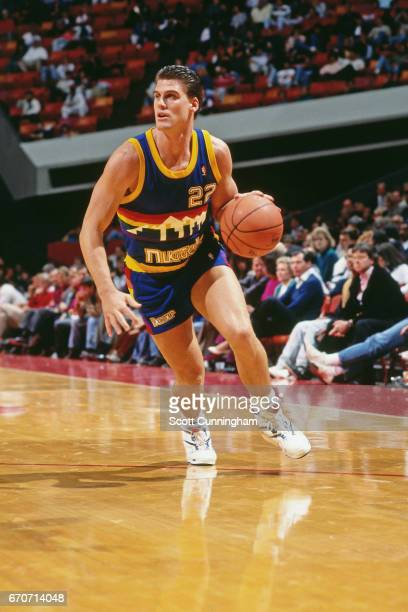 Jim Farmer of the Denver Nuggets dribbles against the Golden State Warriors during a game played circa 1990 at the Omni in Atlanta Georgia NOTE TO...