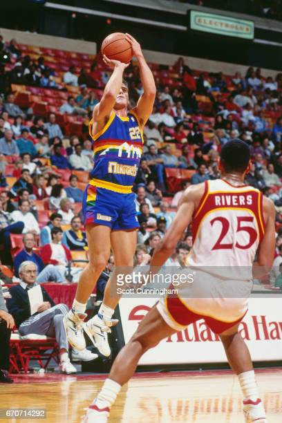 Jim Farmer of the Denver Nuggets shoots against the Golden State Warriors during a game played circa 1990 at the Omni in Atlanta Georgia NOTE TO USER...