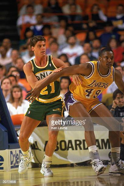 Jim Farmer of the Seattle Supersonics battles for position in a game against the Los Angeles Lakers during the 19891990 NBA season at the Great...