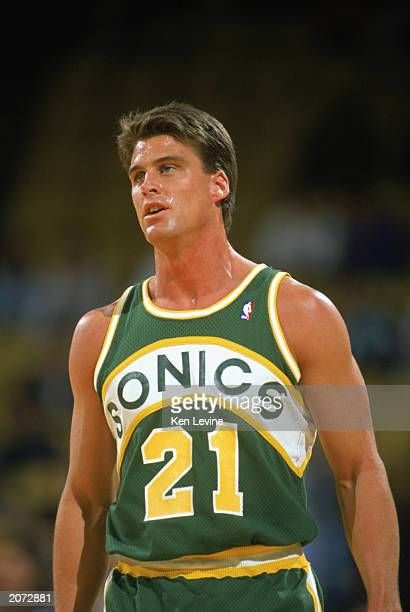 Jim Farmer of the Seattle Supersonics looks on during a game in the 19891990 NBA season