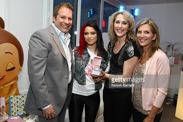 Jim Fielding President Disney Store Worldwide singer Maxine Ashley Robin Beuthin Creative Director NA and Molly Adams SVP Disney Store NA attend the...