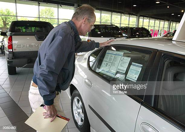 Jim Fraser looks at the sticker price of a new Chevrolet in the showroom of Hoskins Chevrolet June 2 2003 in Elk Grove Village Illinois Auto dealers...
