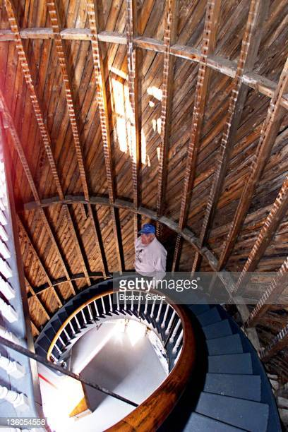 Jim Frey Pres of the Friends of Plum Island Light walks down the lighthouse stairs