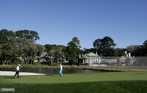 Jim Furyk and Aaron Baddeley look over the green on the 17th hole during the third round of the Verizon Heritage at Harbour Town Golf Links on April...