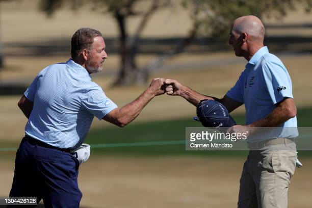 Jim Furyk and Jeff Maggert fist bump on the 18th green during round two of the Cologuard Classic at the Catalina Course of the Omni Tucson National...