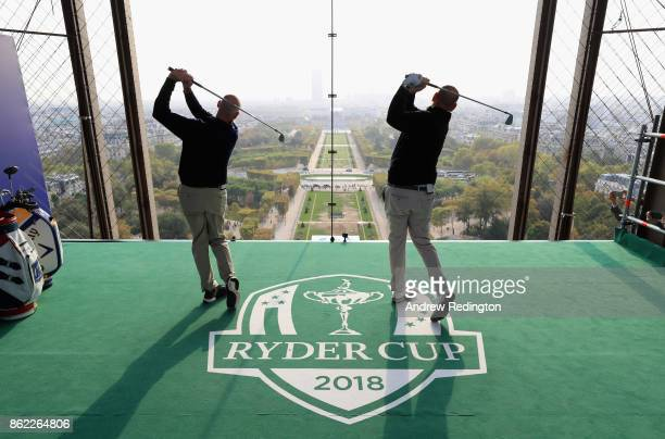 Jim Furyk Captain of The United States and Thomas Bjorn Captain of Europe tee off from a platform on the Eiffel Tower during the Ryder Cup 2018...