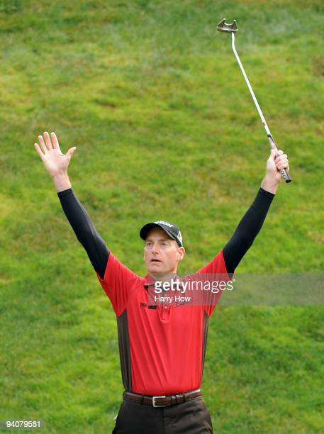Jim Furyk celebrates a long putt to save par on the 17th hole during the fourth round of the Chevron World Challenge at Sherwood Country Club on...