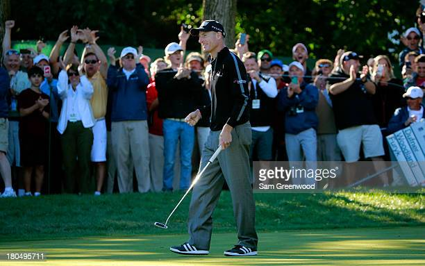 Jim Furyk celebrates after putting on the ninth green to shoot a 59 during the Second Round of the BMW Championship at Conway Farms Golf Club on...