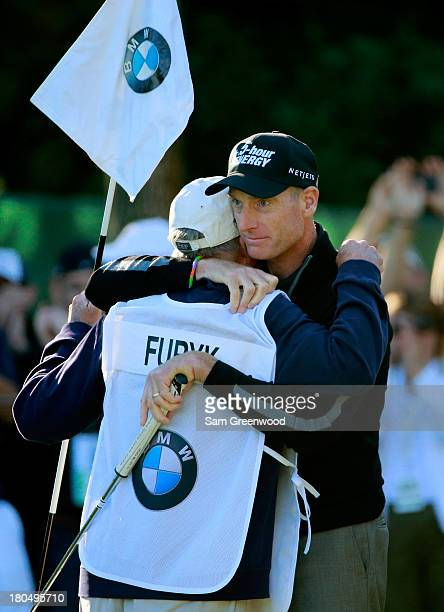 """Jim Furyk celebrates with his caddie Mike """"Fluff"""" Cowan after putting on the ninth green to shoot a 59 during the Second Round of the BMW..."""